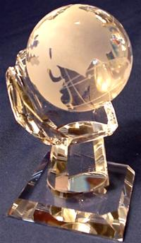 Crystal globe on crystal hand shape base